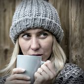 Beautiful blonde female drink coffee uoutdoor