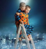 Two young boys on a ladder