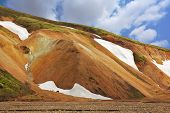 Pink and orange Mountains National Park Landmannalaugar in Iceland. Snow remained on the mountains since last year