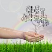 Concept conceptual abstract art design word cloud tagcloud tree on rainbow sky background and grass