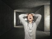 stressed man and dark tunnel