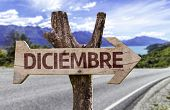 December (In Spanish) sign with a road background