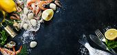 stock photo of clam  - Delicious fresh fish and seafood on dark vintage background - JPG