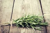 Fresh Bunch Of Rosemary On Wooden Table.