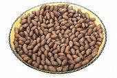 foto of pecan nut  - decorative pottery bowl filled with unshelled pecan nuts - JPG