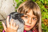 Crow and a little girl