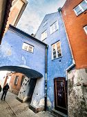 colorful houses with an arch in the center of Warsaw, near the Castle Square, Poland