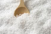 pure sea salt with immersed wooden spoon
