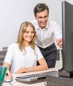 Man and woman working together at the office