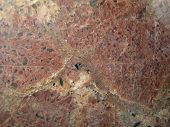 stock photo of feldspar  - polished pink feldspar graphic granite surface background - JPG