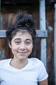 Portrait of positive teen girl, outdoors.