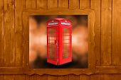 Classic British red phone booth in London UK, wooden window