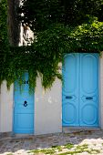 Two blue entrance doors
