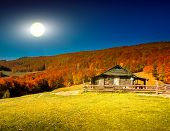 Sunset landscape with old rural house in the Carpathian mountains. Ukraine, Europe