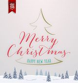 Vintage Christmas Greeting Card With Typography Holiday Label Design. Winter Landscape Background with Blurred Xmas Trees