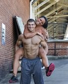 Fitness couple posing in an outdoor environment