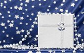 Christmas background with silver Christmas decoration and gift box