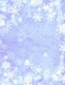 Xmas background of blue color with snowflakes