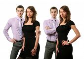 Young business couples isolated on white