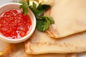 pancake with red caviar closeup