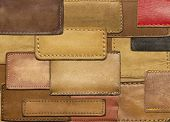 Leather background made of jeans labels