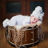 cute baby lying on the drum