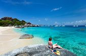 picture of virginity  - Young woman with snorkeling equipment enjoying view of a tropical beach standing on granite boulder at Virgin Gorda - JPG