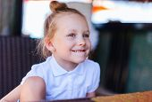 Portrait of adorable playful little girl