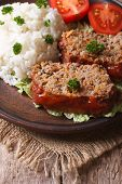 Meatloaf With Rice And Vegetables On A Plate Closeup, Vertical