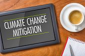 Tablet on a desk - Climate Change Mitigation