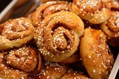 Cinnamon rolls against a dark background
