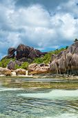 Perfect Tourist Destination to Explore in Seychelles with Stunning Clear Water Lagoon and Attractive Large Rock Formations. An Exotic Paradise in La Digue Island. poster