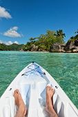 Canoeing offshore in the Port Launay Marine national park, Seychelles facing towards the coastline with its lush tropical vegetation