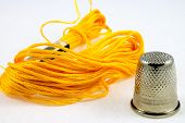Soft Yellow Cotton Thread And A Thimble