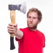 Portrait Of Bearded Lumberjack With An Axe