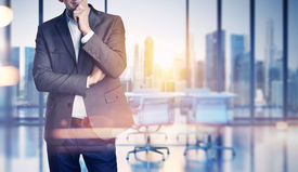 picture of roof-light  - Businessman on blurred city and office background - JPG