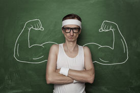picture of nerd glasses  - Funny sport nerd with fake muscle drawn on the chalkboard - JPG