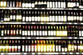 stock photo of liquor bottle  - Blur or Defocus image of Wine on the Shelf of Liquor Store - JPG