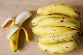 stock photo of bunch bananas  - ripe peel bunch banana on wooden cutting board - JPG