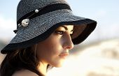 pic of arabic woman  - Photo of a beautiful woman in black stylish hat - JPG