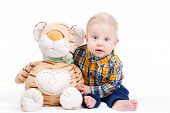pic of tiger cub  - Portrait of a smiling little boy in a plaid shirt and blond hair - JPG
