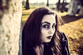 image of scary face  - Girl with scary face painting and long hair outdoor - JPG