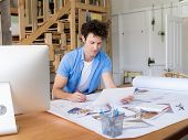 foto of draft  - Man working with drafts in office - JPG