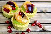 pic of tarts  - Three small fruit tart on wooden table - JPG