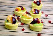 image of tarts  - Many small fruit tart on wooden table - JPG