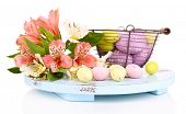 image of easter basket eggs  - Easter composition with Easter eggs in basket and flowers - JPG