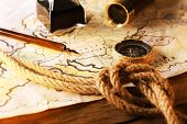 foto of marines  - Marine still life with world map and rope on wooden table background - JPG