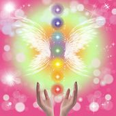 pic of pastel colors  - Healing Hands and seven chakras on a sparkling pastel coloured background - JPG