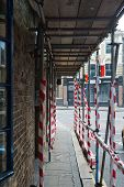 picture of scaffold  - Building scaffolding over the pedestrian footpath composition - JPG