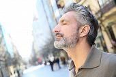 stock photo of serenity  - Portrait of serene mature man in town - JPG